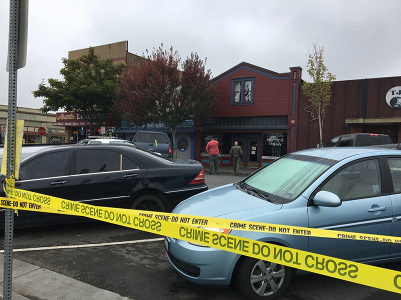 The taped-off crime scene at bar row on the Arcata Plaza. - THADEUS GREENSON