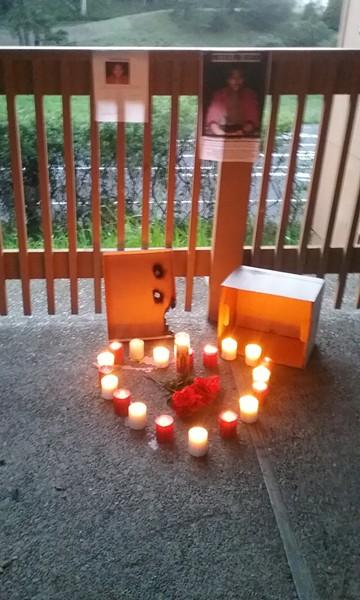 Candles lit in honor of David Josiah Lawson - LINDA STANSBERRY