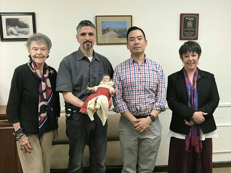 From left to right: Marie Escher, special agents Dave Keller and Joe Hong, and Diane Johnson at the March turnover. - SUBMITTED