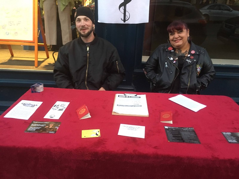 Nathan Irvine and Rachel Montoya table for IWW. - SUBMITTED
