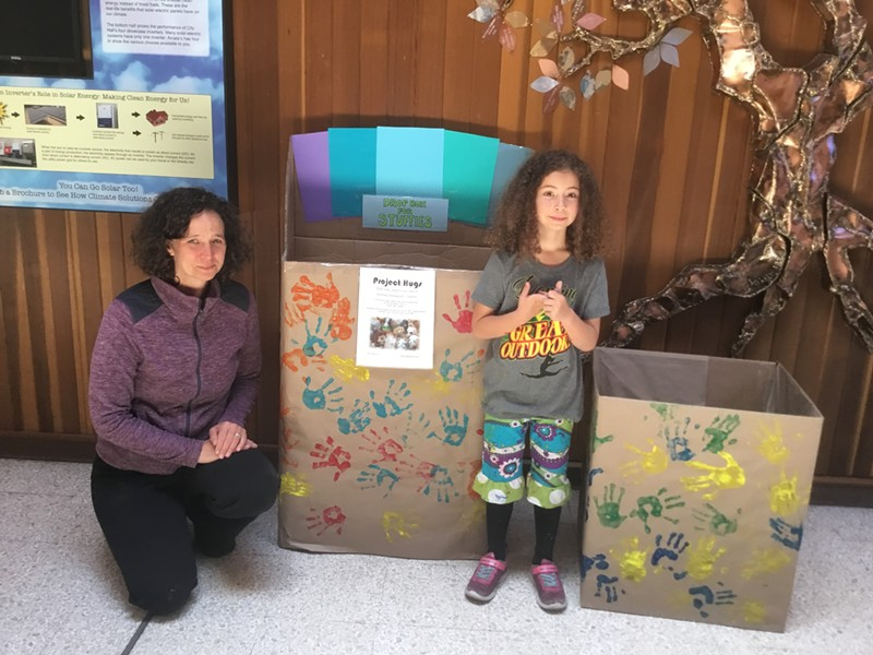 "Amy Tetzlaff and her daughter Iris place donation boxes for stuffed animals in Arcata City Hall. The huggable toys will be sent to immigrant children in ""tender age"" shelters. - PHOTO COURTESY OF MAUREEN MCGARRY"