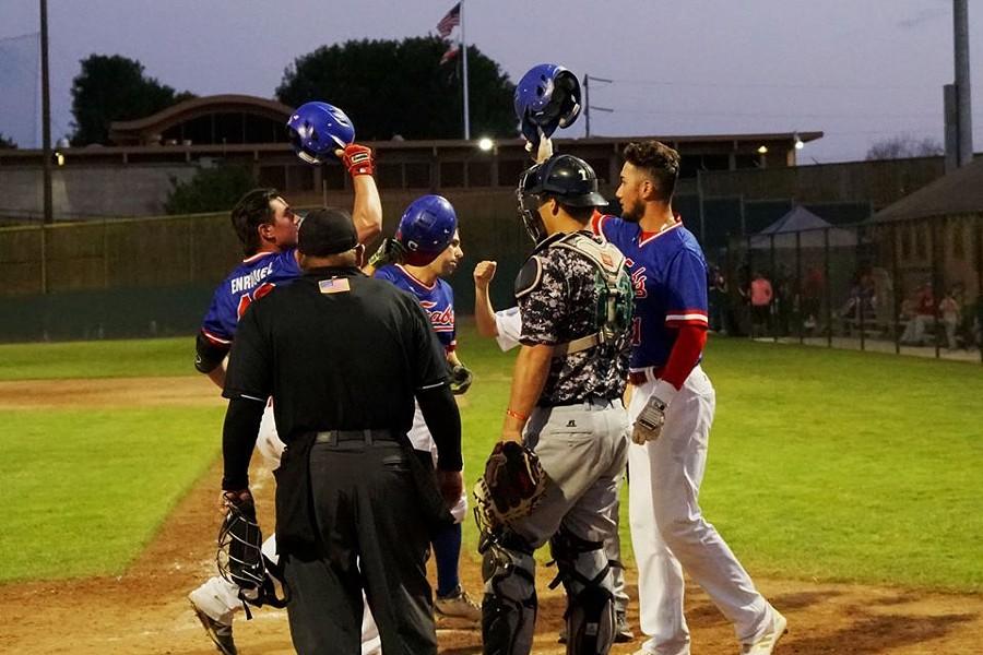 First baseman Ramon Enriquez celebrates a home run - MATT FILAR
