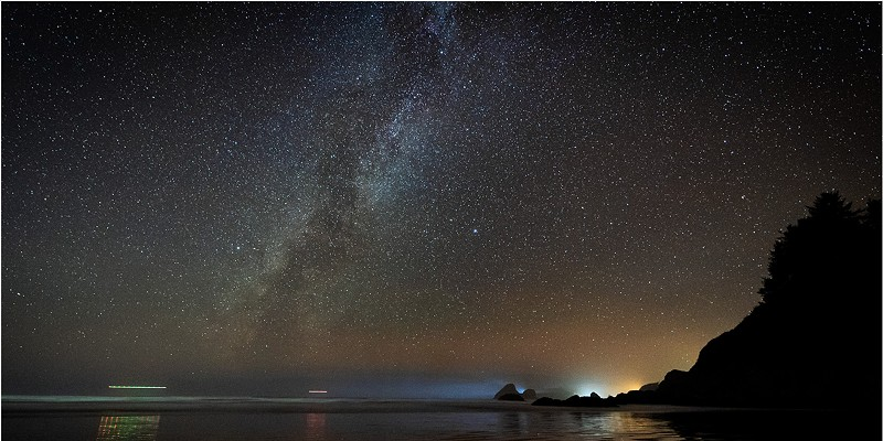 Reflections at Moonstone Beach. While we waited for meteors, a pair of helicopters skimmed the horizon as blinking dots sliding toward Trinidad's glow. The rest of the galaxy hanging overhead didn't notice us. Humboldt County, California., November 21, 2019.