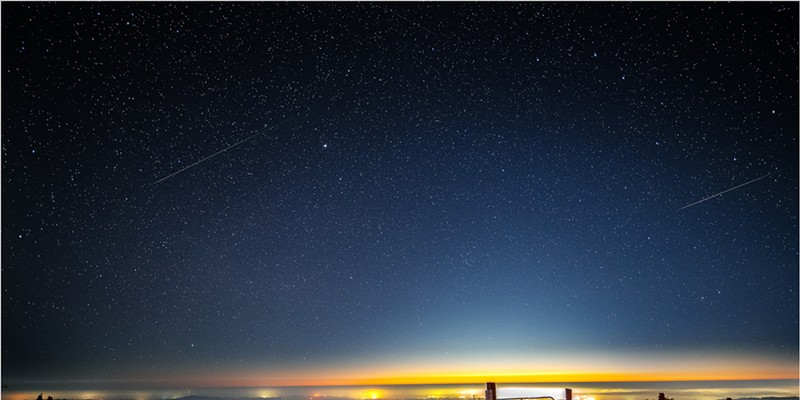 """""""Self Portrait with Perseid Meteors."""" The lights of Eureka shine on the Pacific Coast beneath a pair of Perseid meteors in this composite of two images from a timelapse sequence taken during the Perseid meteor shower of 2020 from the hills of Humboldt County on Aug. 12."""