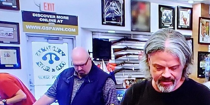 Wolf Navarro inspecting a vintage Fender on Pawn Stars.