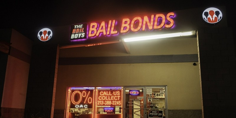 """The Bail Boys bail bonds displays a """"No on Prop 25"""" poster in downtown Los Angeles on Oct. 21, 2020. Prop. 25 would end California's current cash bail system and replace it with a three tier risk assessment system."""