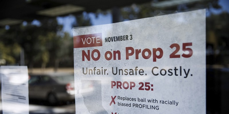 A sign against Proposition 25 is displayed at Bad Boys Bail Bonds on Oct. 12 in San Jose.