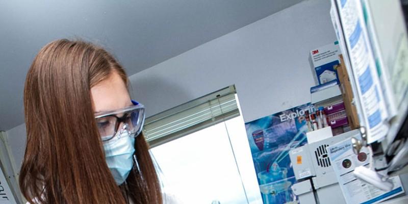 Humboldt County Public Health Laboratory staff member Alyssa McCloud catalogs incoming tests.