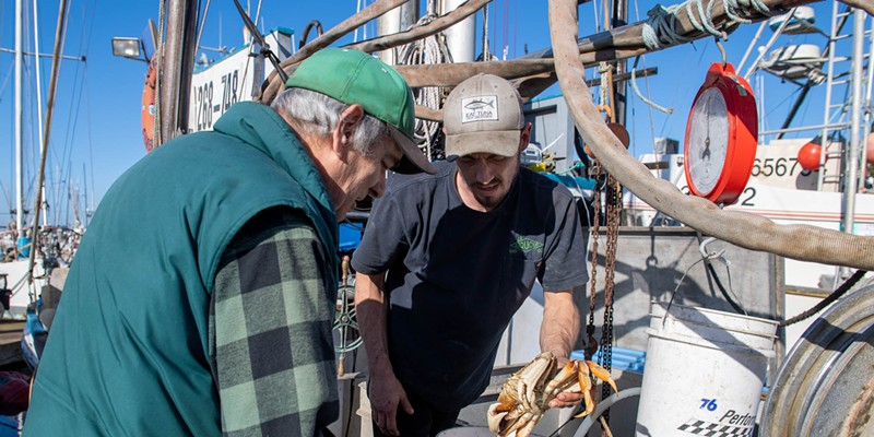 Tony Burris of the Corregidor weighs crab for former Eureka mayor and coroner Frank Jäger.