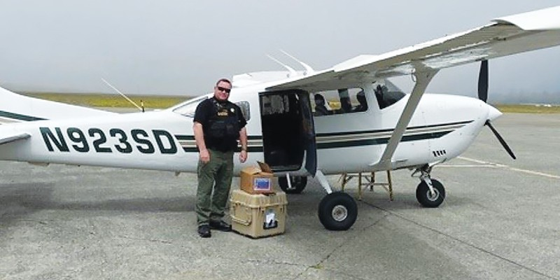 Humboldt County Sheriff's Lt. Kevin Miller receives a vaccine delivery from Fresno County on May 5.