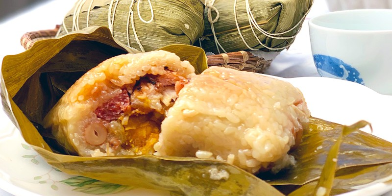 A piping hot sticky rice dumpling packed with treasures.