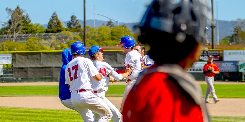 Teammates congratulate Crabs second baseman Ethan Fischel after he hit the game-winning RBI in the bottom of the 13th inning to give the Humboldt Crabs their first series win of the season with a 5-4 win over the Lincoln Potters in the third game of the series at Arcata.
