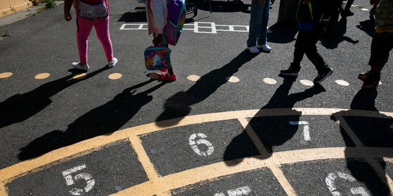 Rising first graders walk to their classroom at the start of the day during summer session at Laurel Elementary in Oakland on June 11, 2021. Laurel is a hub program for five district schools hosting 120 kids for the summer with a focus on resocialization in addition to academics.