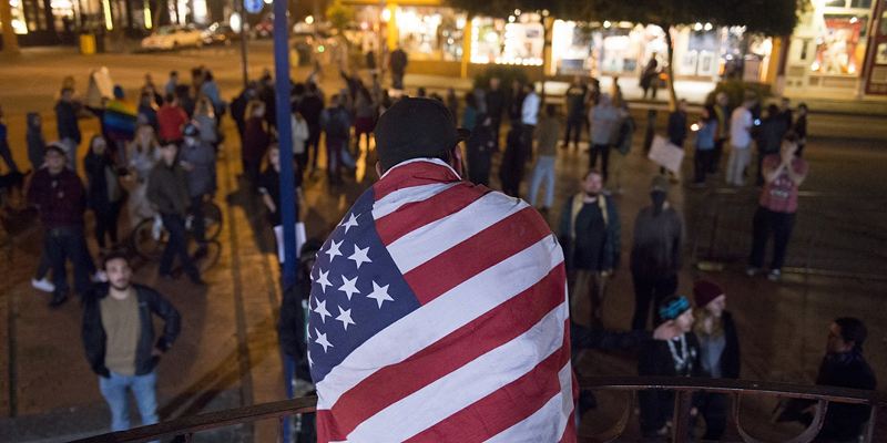 A pro-Trump counter protester at the Old Town gazebo on Thursday evening.