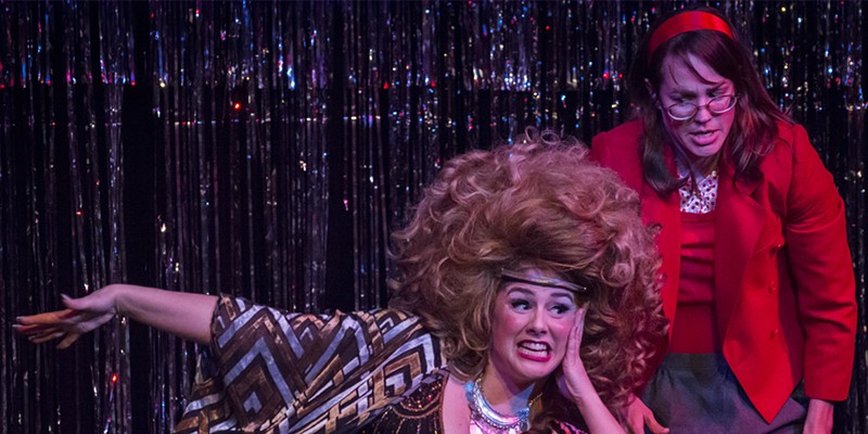 Sarah McKinney as Velvet Q. Jones and Alyssa Hughlett as her dowdy, clumsy assistant Nancy.