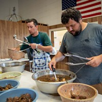 Fatima Feast Nicholas Fisk, right, and Matthew Lorenzo separate the meat from bone, fat, and spices for serving. Mark McKenna