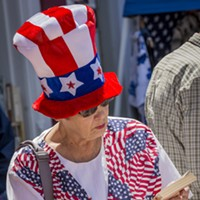 Fourth of July 2016 LeAnne Morini, of Eureka, checks out a book offered for sale for a dollar at Eureka Books' outside tables. Mark Larson