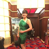 Oscars 2017 Emily Jacobs in emerald with a derby-worthy hat. Jennifer Fumiko Cahill