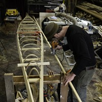 Kayak After assembling the frame and adding in the ribs, Mike Shimelpfening shapes the keel. Jason Self