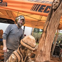 New Slideshow Jason Storey, of Fairfield, Pennsylvania, inspects his chainsaw wood sculpture on Friday before it headed into the final display. Photo by Mark Larson