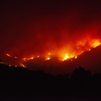 Fire burns the hills north of Upper Lake on Tuesday night.