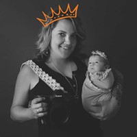 Kelsey Marchi, owner of Kelsey Marchi Newborn Photography, voted Best Photographer, with newborn Reegan Waters.