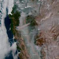 Satellite imagine of wildfire smoke.