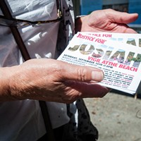 Meg Stofsky holds handbills for a Justice for Josiah vigil happening this weekend at the Manila Community Center.