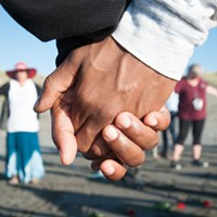 Vigil attendees joined hands in a circle to remember David Josiah Lawson.
