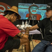 Nahaan (left), of Seattle, focuses on the design style of Northwest Pacific Coast practices, designs and customs of ceremonial tattooing.
