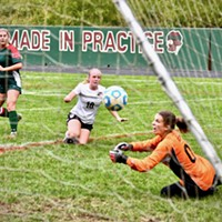 Athena Miller, striker with the Eureka Loggers, watches her kicked ball go into the nets for a goal as Arcata Tiger goalie Sophia Belton stretches out in dismay.