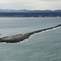 The North Jetty, where a surfer was rescued by an off-duty Coast Guard civilian employee.