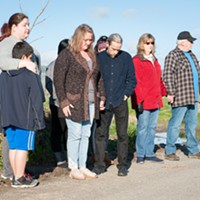 """Carleigh Arnold, third from left, sung """"Amazing Grace"""" during the vigil."""