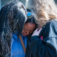 Charmaine Lawson is hugged by supporters shortly before addressing students, faculty and the community on the HSU Quad on Friday, the 23-month anniversary of the killing of her son, David Josiah Lawson.