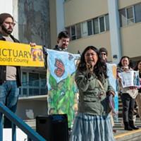 Brenda Perez emcees Centro del Pueblo's demonstration.