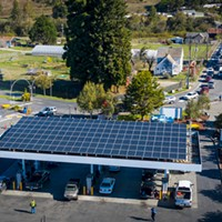 A line of cars waiting to fuel up stretches down the block at the Blue Lake Rancheria gas station, which used microgrid technology, including the solar panels above the pumps, to keep operating during the blackout.