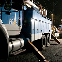 PG&E employees work to replace a nearly 100-year-old utility pole in Berkeley last year.