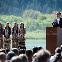 North Coast Congressman Jared Huffman, flanked by Yurok dancers, shortly before the signing of an agreement to remove four hydroelectric dams along the Klamath River in 2016.