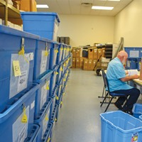 Boxes of ballots wait to be processed and counted at the Humboldt County Elections Office in 2018.