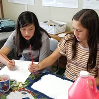 Two students — Haylee (left) and TeMaia — doing an art project in the Del Norte Indian Education Center After School Program at Crescent Elk Middle School.
