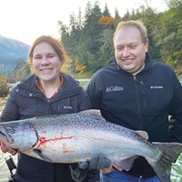 Minda Lawrence and Grant Vallier, of Lakeview, Oregon, hold one of the two kings they caught to limit out Saturday on the Chetco River while fishing with guide Michael McGahan of Wild Rivers Fishing.