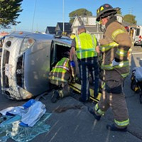 Emergency personnel carefully remove the driver from their vehicle. [All photos by Mark McKenna]