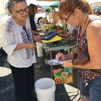 Donna Roudebush of Fortuna Union Elementary School District with Holly Kreb      of Flood Plain Produce at the Fortuna Farmers Market.