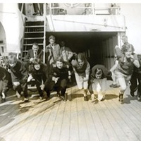 Women runners of the US Olympic team practicing on the high seas aboard the  S.S. President Roosevelt in 1928. Left to Right: Elta Cartwright, Elizabeth Robinson, Ann Varana, Mary T. Washburn, Olive B. Hasenfun, Loretta McNeil and Edna E, Sayer. Coach Mel Sheppard is seated on the ladder.