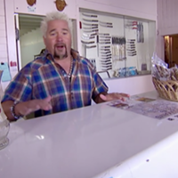 Fieri behind the counter at the Ferndale Meat Co. on his show Diners, Drive-ins and Dives.