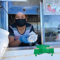 Francisca Vereugo serves up a burrito from the Taqueria Martinez truck.