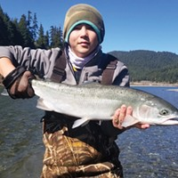 Tyler Bishop, of Eureka, holds a nice steelhead caught Monday on the Eel River.