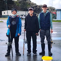 Ava Mark (left), Kitty Truong and their big fishing brother Yeng Thao.