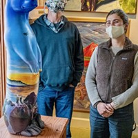 Jeff Black and Michelle Kunst standing by Maureen McGarrys North Coast Otter sculture at the Simmons Gallery.