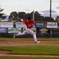 Crabs infielder David Morgan (#20) makes a play on a ground ball at third base on June 12, 2021 while facing Seals Baseball at Arcata Ballpark.